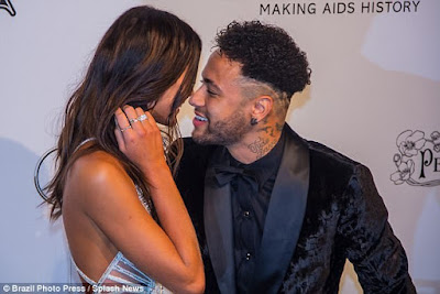 Footballer Neymar kisses his girlfriend Bruna Marquezine as he walks in crutches at event in Brazil