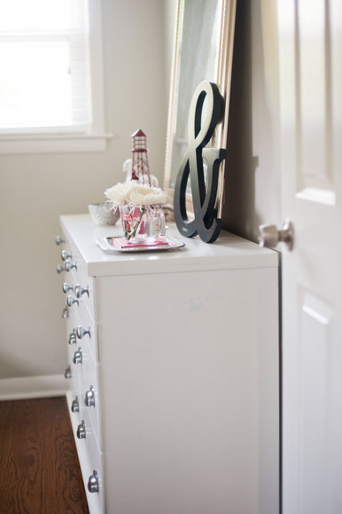This white dresser provides plenty of storage and looks great on the wood floors.
