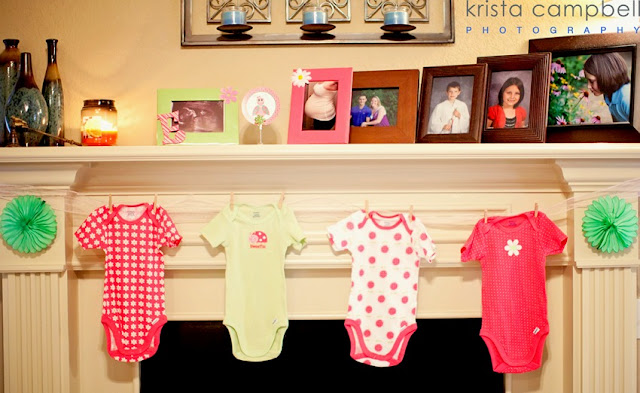 onesies hanging, pink onesies, nany shower, lil ladybug, pink & green