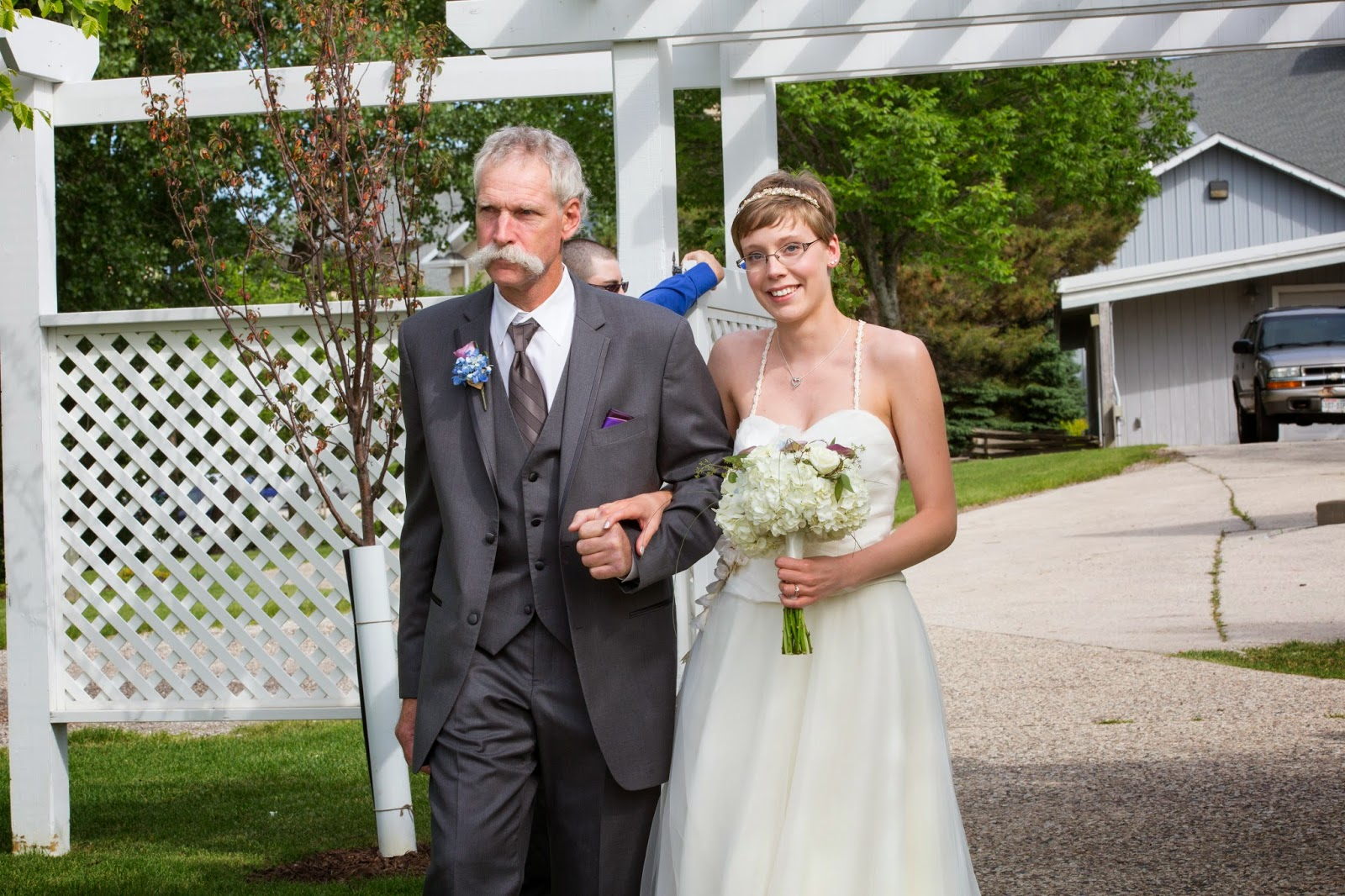 Photo of my beautiful wife being escorted down the aisle by her father.