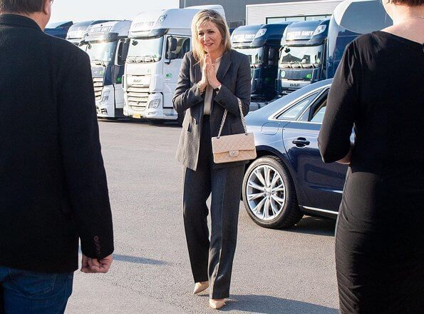 Queen Maxima wore Massimo Dutti herringbone blazer and trousers, suit. Gianvito Rossi pumps, carries Chanel bag