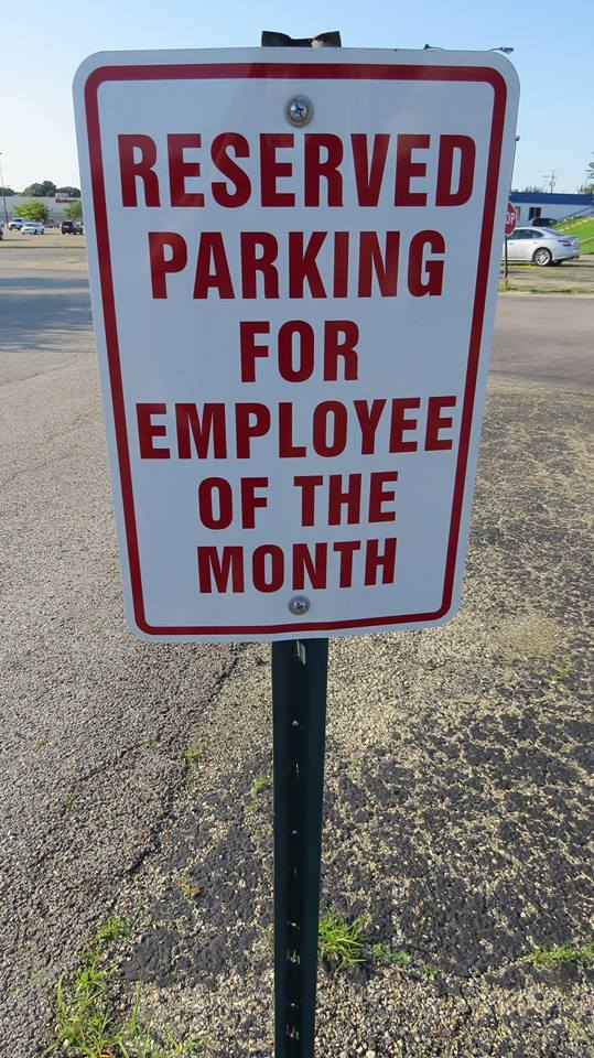 Lensing and Shuttering Employee of the Month parking spot