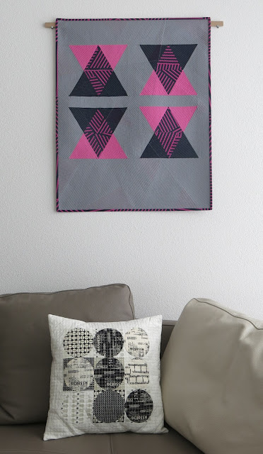 Luna Lovequilts - A modern triangle quilt with transparency effect