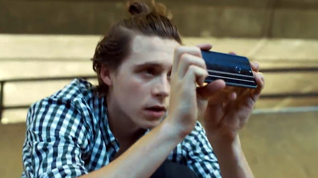 Brooklyn Beckham with man bun and the Honor 8 capturing photos at skateboarding