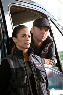 "Paula Patton and Simon Pegg in ""Mission Impossible - Ghost Protocol"""