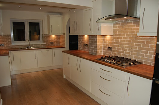 Ivory kitchen with bow handles and walnut worktops supplied and fitted in Oulton Leeds