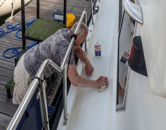 Photo of Phil using rubbing compound to remove marks from Ravensdale's gelcoat