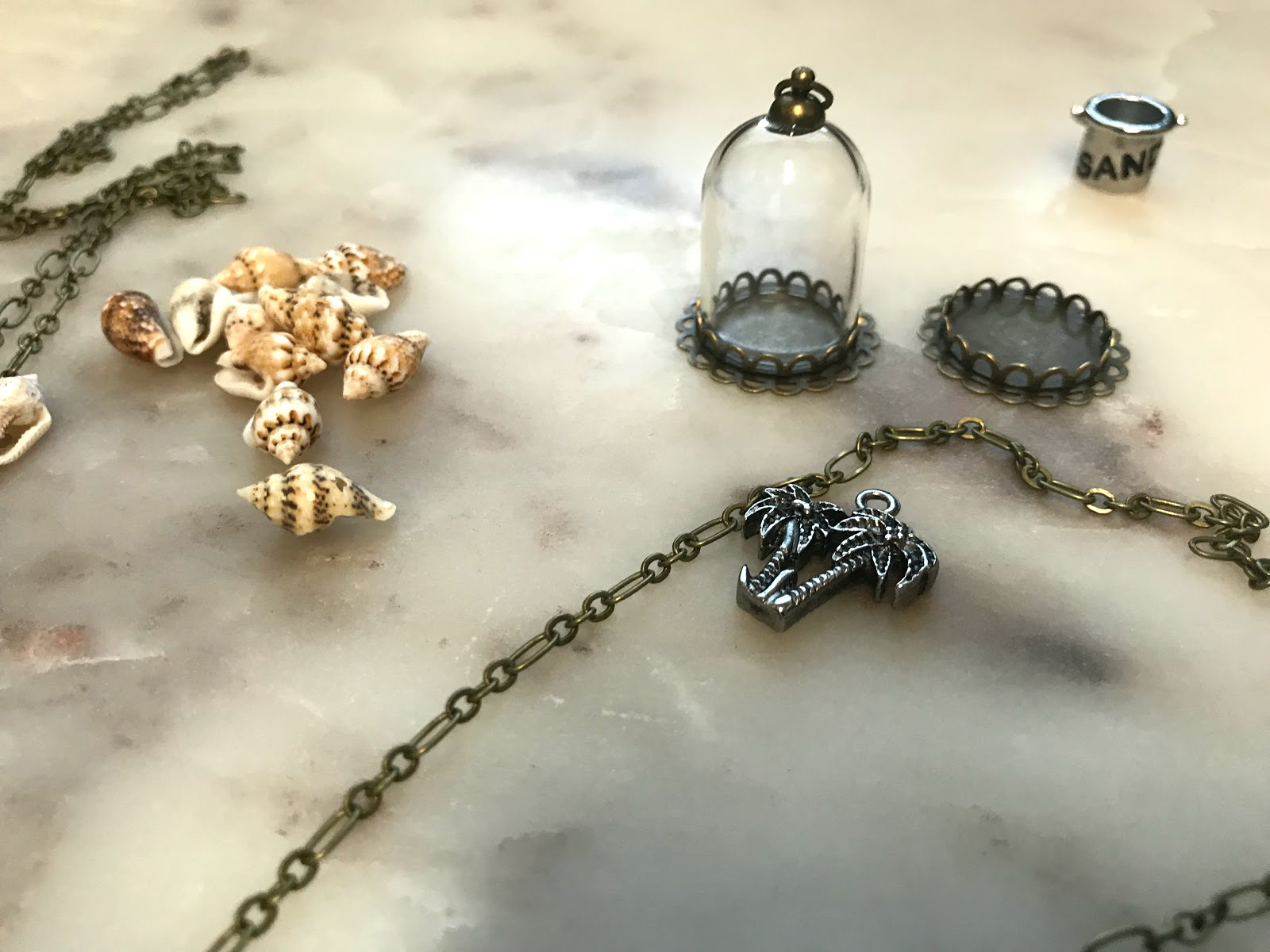Sometimes I use charms, sand or  I use tiny rocks from outdoors. The cost of this makes it yourself necklace is under 8 dollars. Now that is a win to get happy about.