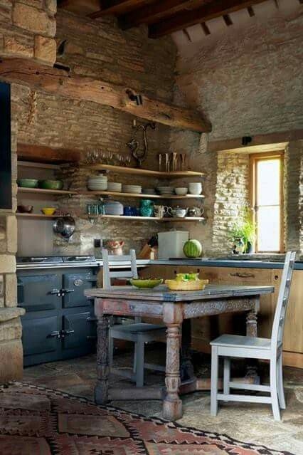 Rustic kitchen in #Frenchfarmhouse with distressed furniture, AGA stove, and open shelving on Hello Lovely Studio