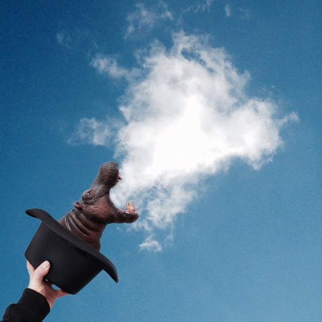 09-Magic-by-Pulling-a-Hippo-out-of-the-Hat-Marcus-Einspannier-Surreal-Digital-Photo-Manipulation-using-Clouds-www-designstack-co