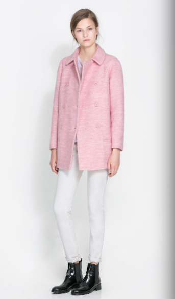 Soft pink in combination with white in a designer outfit