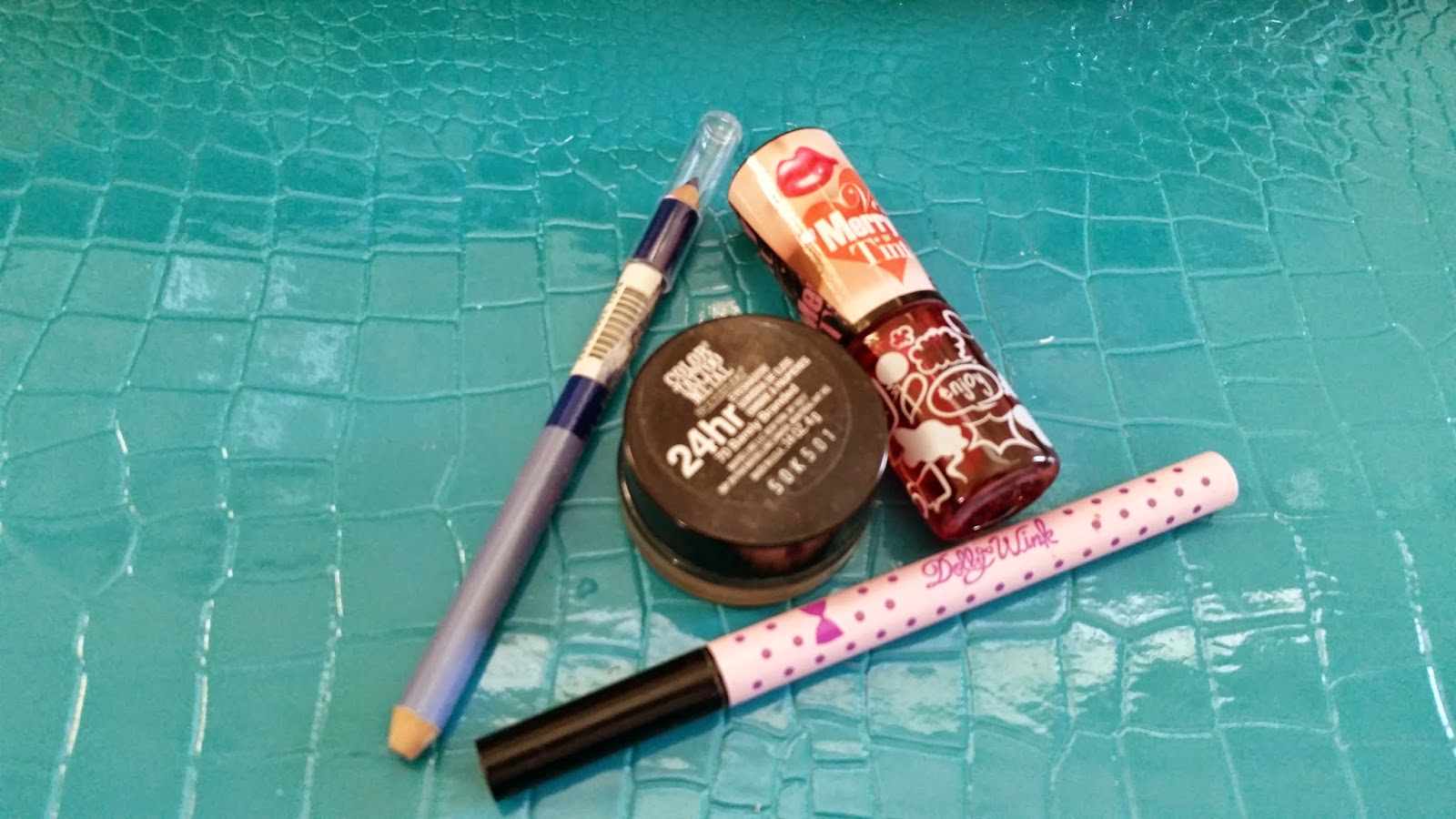 Dolly Wink liquid liner, YET gel-jelly lip tint, Maybelline 24 hour cream eyeshadow, random blue eyeliner