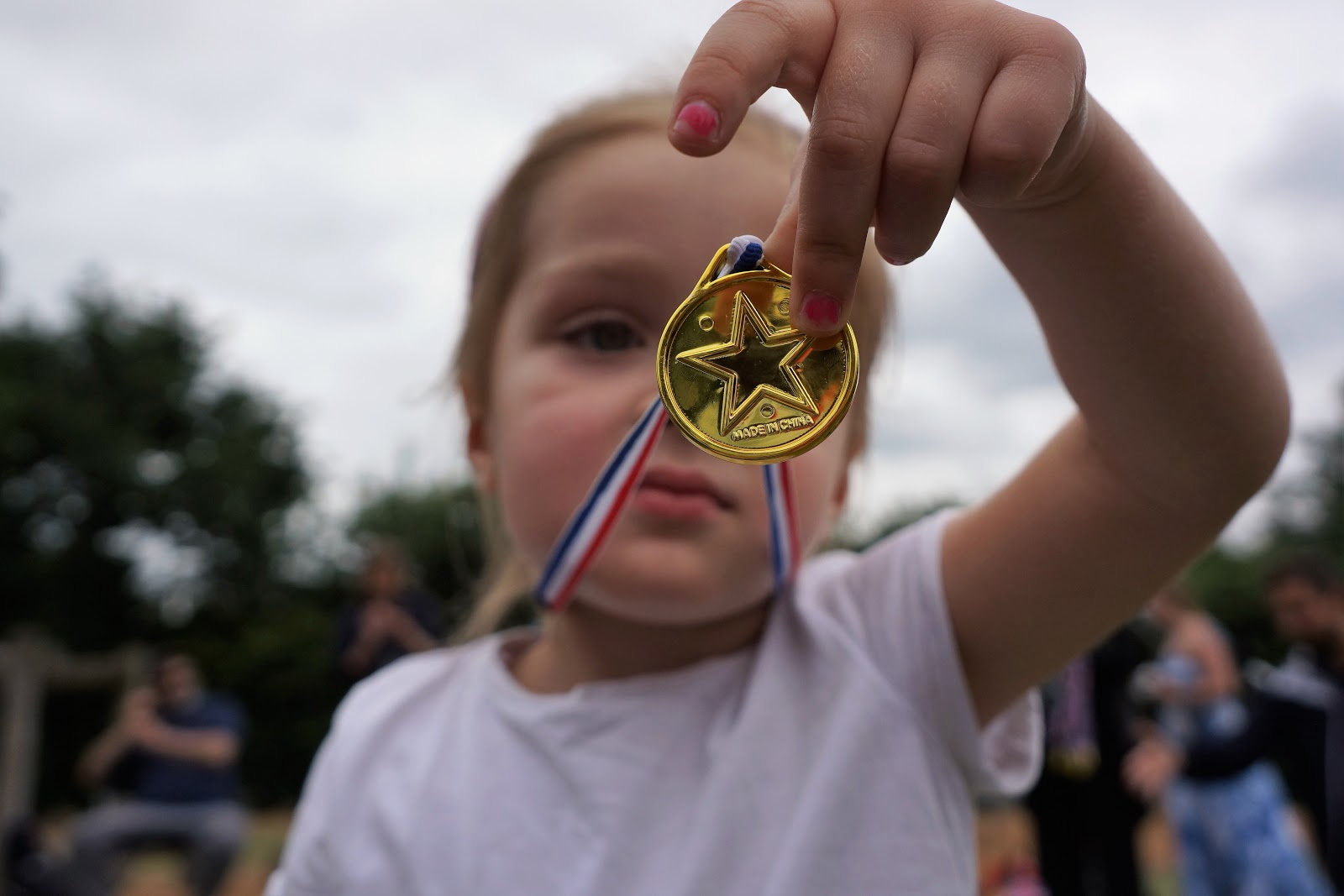 girl with a medal at school sports day
