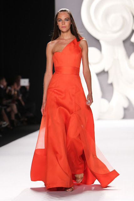 94f80e597bb Carolina Herrera takes a strong color and makes it her own with Tango  Tangerine and this one shoulder chiffon crepe evening gown.