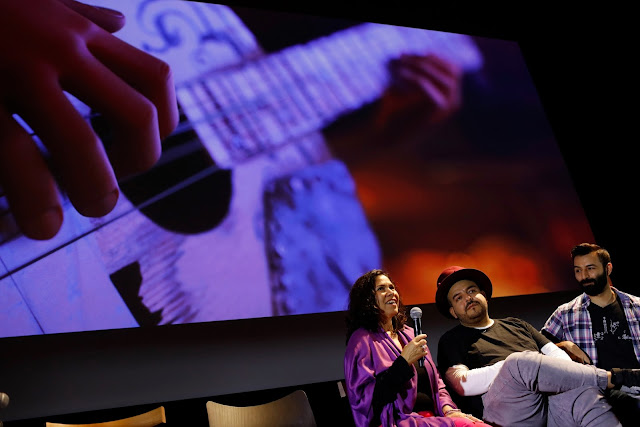 Germaine Franco and Camilo Lara on stage at Pixar for Coco