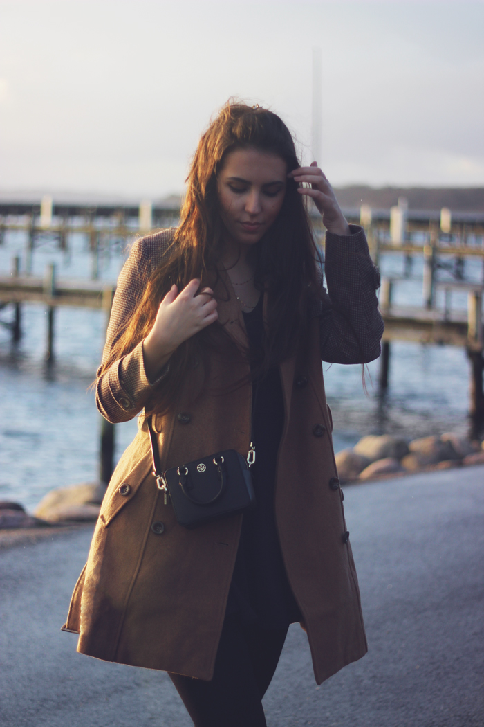 miss patina camel coat outfit