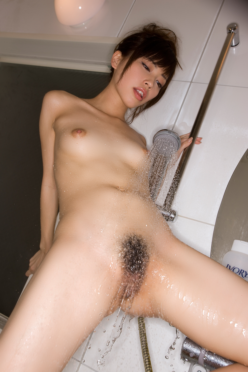 Hot asian chick takes a shower