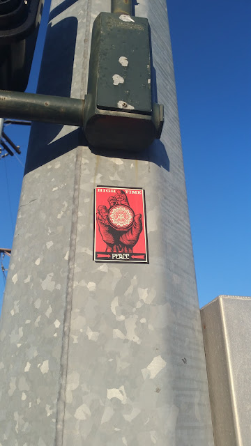 An odd place for an Obey sticker to show up.