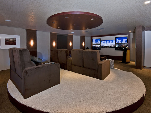 Picture of large home theater with brown sofas