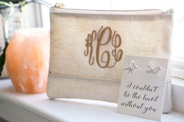 monogrammed clutch ad bow earrings