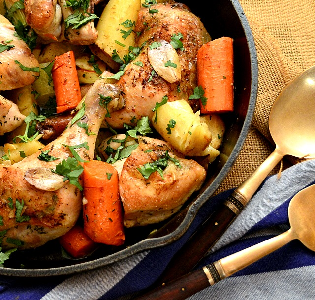 chicken and vegetables in cast iron skillet
