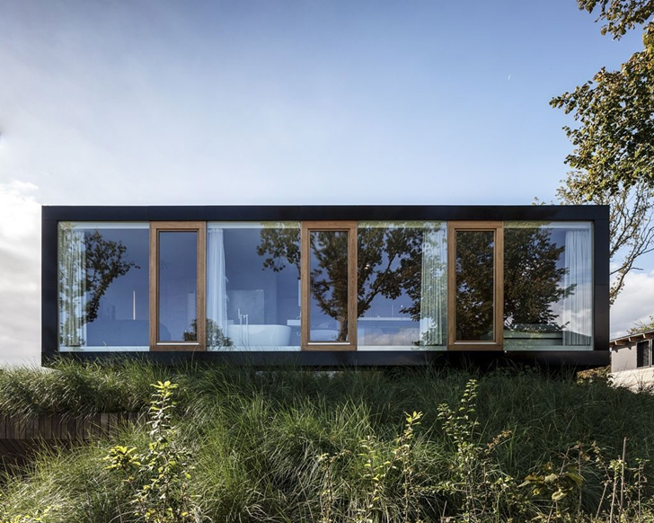 Facade of Modern Villa V by Paul de Ruiter Architects from the street