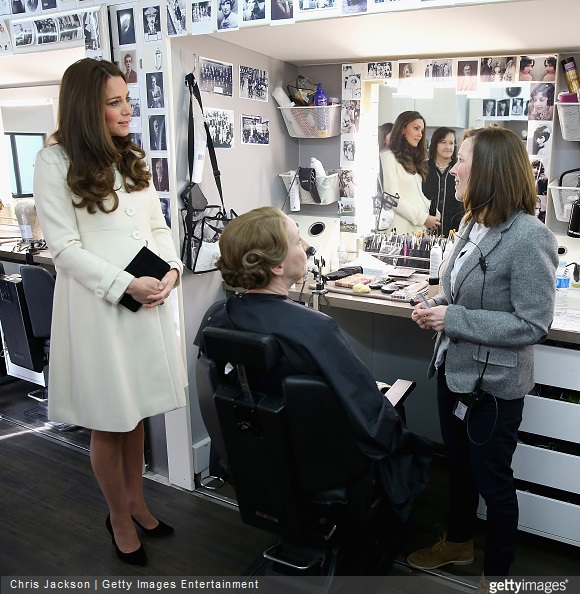 Catherine, Duchess of Cambridge chats to Nic Collins in hair and make up as actress Phyllis Logan is made-up (Mrs Hughes) during an official visit to the set of Downton Abbey
