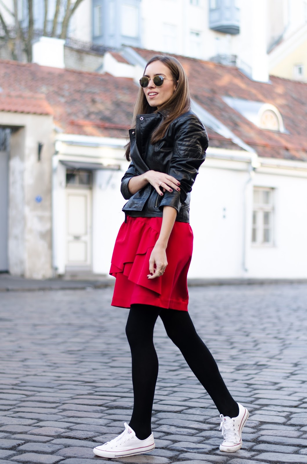 kristjaana mere leather jacket red skirt sneakers winter outfit