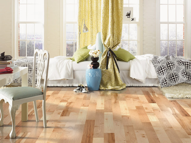 Beautiful, light hardwood floor shines in this bedroom
