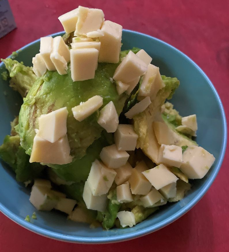 Mixing cheesy avocado ice cream ingredients in a bowl
