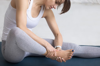 A woman stretching after a workout