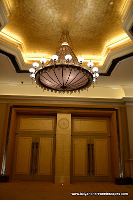 golden doors and chandelier inside Abu Dhabi's Emirates Palace