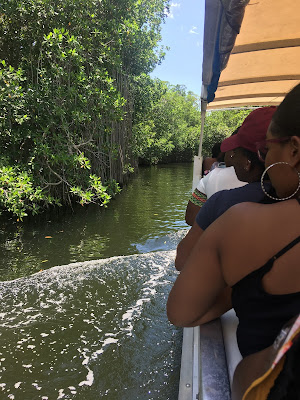 ladies on a boat ride up black river at Jamaica black river safari, Chevy Takes The Mic Jamaican Travel Blog Series Adventures in St. Elizabeth