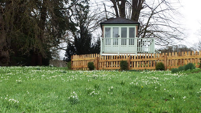 Summerhouse and snowdrops at Easton Walled Gardens