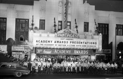 Photo of Pantages Theater dated April 6, 1959 with police officers standing in front to allow stars arrival to 31st Annual Academy Awards ceremony