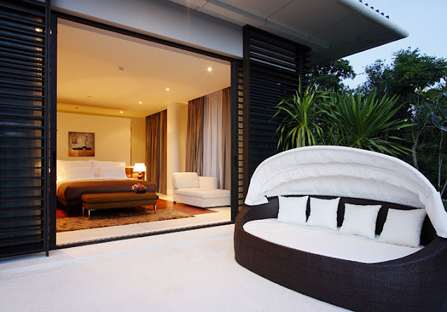 Photo of black and white furniture on the terrace of modern villa in Phuket