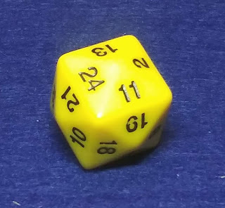 a yellow d24. In a sense, it looks like a cube, but each face has been bulged out to form four triangles, each a quarter of the side of the cube.