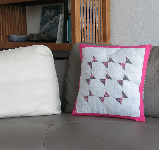 Luna Lovequilts - Butterfly quilted cushion on the sofa