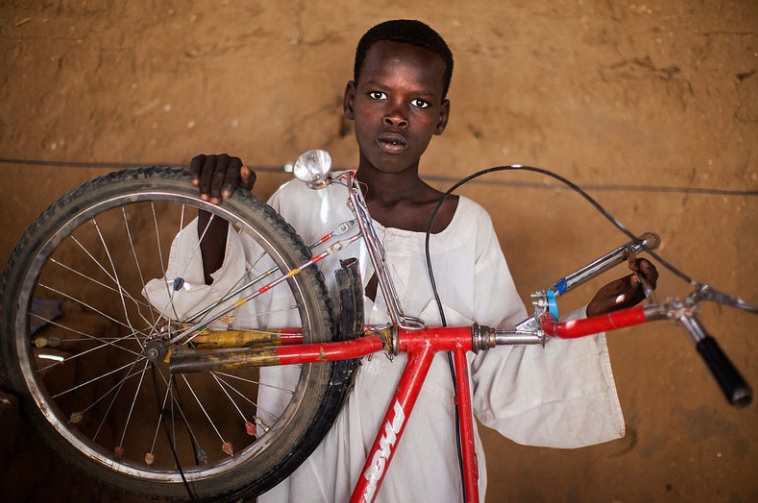 Hamza Ahmad in North Darfur, Sudan with his bicycle