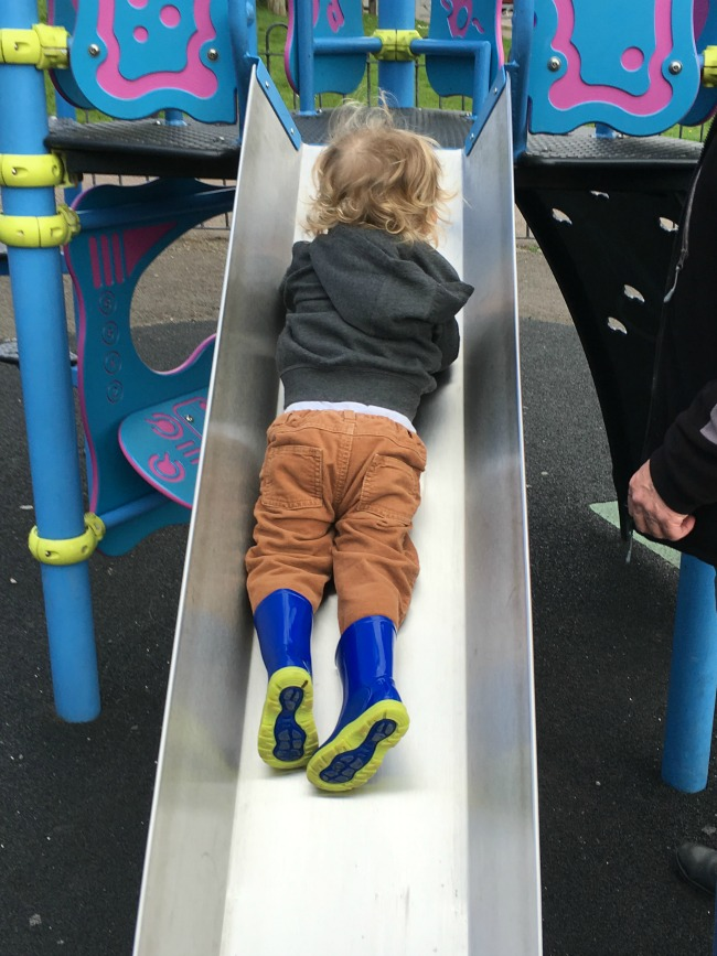 toddler face down on slide