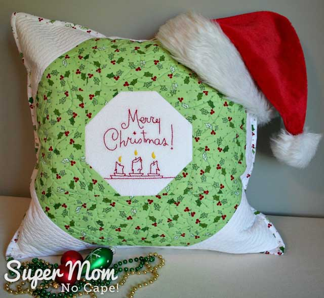 Learn how to make a quilted Christmas wreath pillow / cushion cover. Tutorial by Super Mom No Cape!