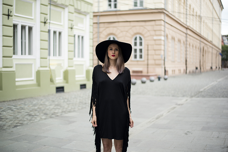 Dark necessities are part of my design black plunging fringe dress