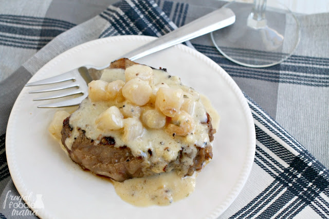 Juicy tenderloin steaks are marinated in a flavorful coffee marinade and then topped with a simple yet elegant scallop tarragon cream sauce.
