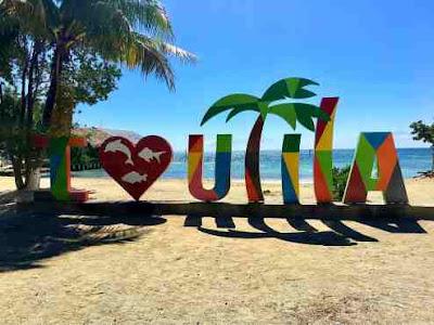 Utila sign on Beach