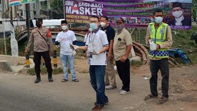 Edukasi Prokes Di Lampu Merah Rajeg, Paseba Tangerang Utara dan Manajemen Pasar Pelangi Bagikan Ribuan Masker
