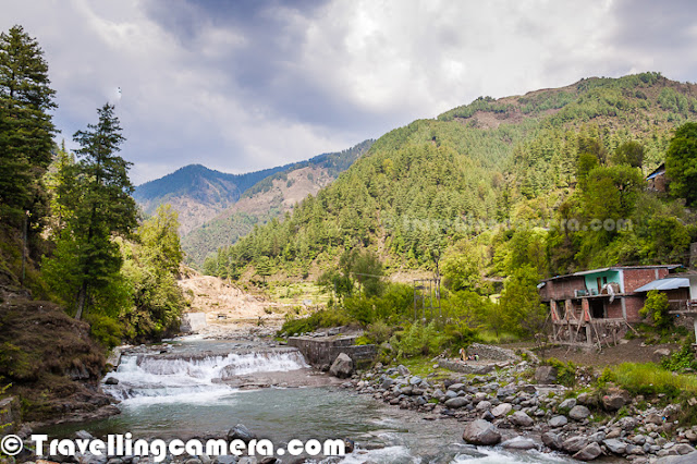 We visited Barot, a tiny town in Mandi District of Himachal Pradesh, in 2013. It was almost an impromptu visit and turned out to be absolutely worth the long drive. And this is the place that I am going to revisit today in this Time-Turner Post.   The Time-Turner series is my opportunity to relive some of my most memorable travels. In this series I reflect upon the lasting impression of a travel destination and talk about the memories that have persisted over the years. Barot is definitely the place that I would want to relive and revisit. The reasons, you will find out below.   The first thing I remember about this trip to Barot was that we went there in an old Maruti 800 with friends. And en route we stopped to have stuffed parathas that had stuffing I had never heard of. It was some Himachali specialty and tasted absolutely out of this world. Accompanying the parathas was galgal ka achaar and chai. What else could one ask for?   The drive after that was fairly long and when we reached Barot, we were shocked to find that our booking at the Government Guest House had been unceremoniously cancelled because some senior Government official had suddenly made plans to visit the town. We decided not to get into any arguments and search for another accommodation. Luckily there were several homestays close by and we were able to find one at a very reasonable price. By now, we were famished, so decided to freshen up and head for lunch.   I also remember that our balcony overlooked the River Uhl that flowed over a rocky bed and had waters as clear as glass. We could see fish swimming in the flow. Across the river was a small dhaba llike restaurant, and that is where we headed for our lunch. I remember having some really tasty chicken curry with tandoori roti. It was heavenly, really. After that we went for a walk along the river and soon found ourselves in lush green meadows where locals were happily passing by. I clearly remember an old lady, dressed in traditional Himachali attire walking with the support of a walking stick. She smiled at us as she crossed us.   We happened upon a trout farm and I do not remember much of it, but I do remember people talking about trout that is served whole in Barot and is really tasty. I didn't get an opportunity to taste it though. However, we did come across a local artisan weaving the traditional Mandi shawl. That was quite a fascinating process as well.   By the time we returned from our walk, the sun had set and the locals were preparing for the night. This was when we spotted our landlady chasing a hen and her chicks. Soon she had her under a wicker basket and it was then that we realized that she was putting them away for the night. The birds did make her chase them for quite some time though. It was a sight that one will never see in cities.   We only had a night in Barot and whenever I think of the place I feel that it is perfect for a writer to stay for a few months to finish off that difficult novel. You can find folklore, peace, and simplicity here, which are all quite conducive to writing. Go ahead, try it for yourself.