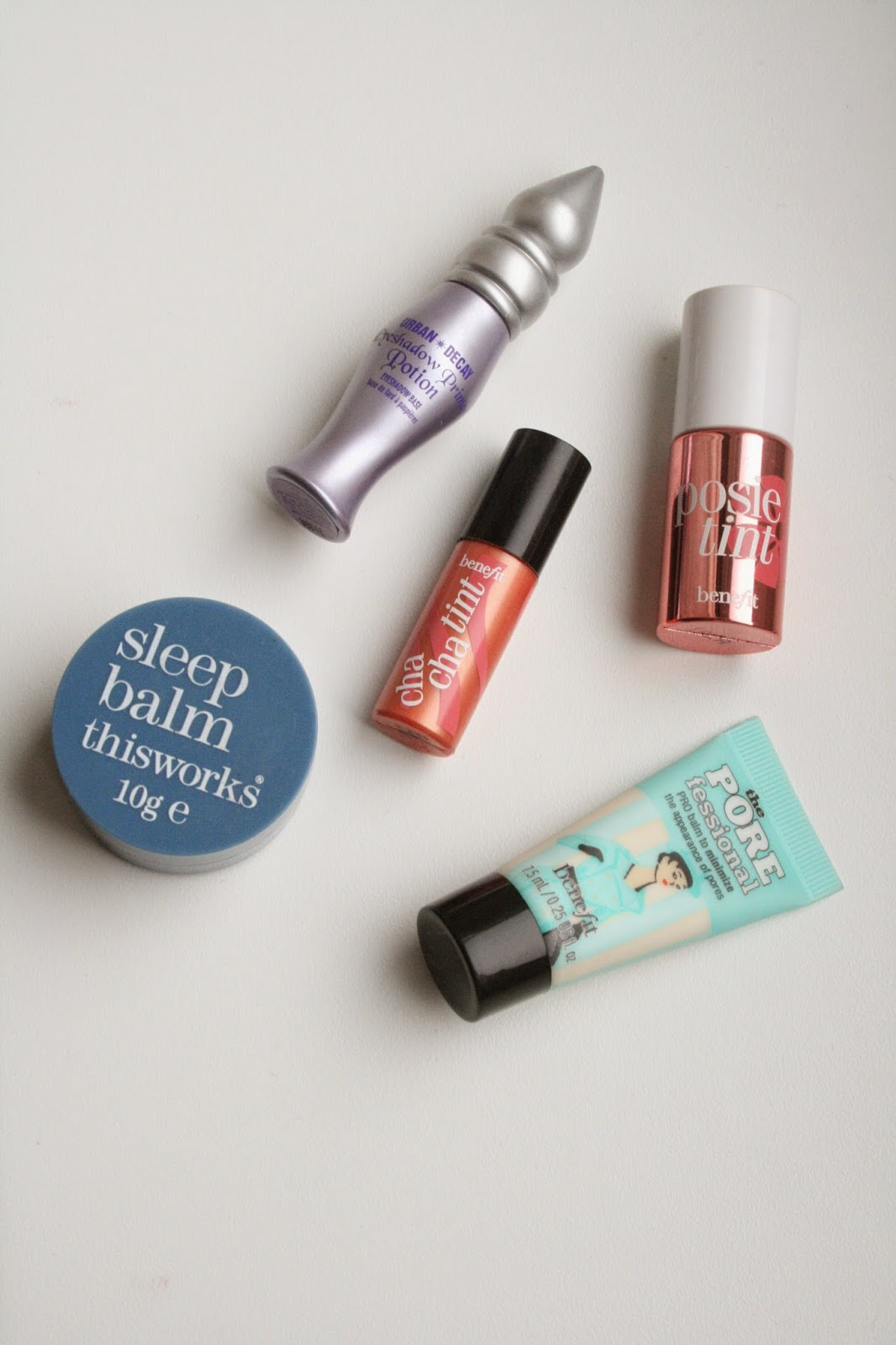 This Works Sleep Balm, Urban Decay Eyeshadow Primer Potion, Benefit Chacha tint, Benefit Posietint, Benefit Porefessional