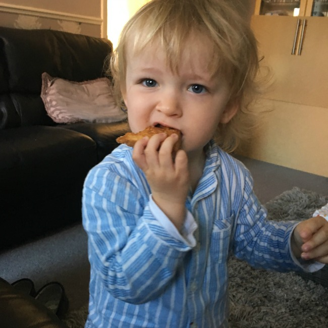 toddler eating toast
