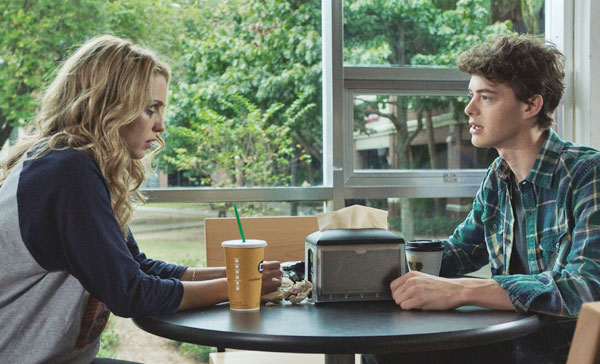 Tree (Jessica Rothe) and Carter (Israel Broussard) trying to figure out about her deja vu situations in HAPPY DEATH DAY (2017)