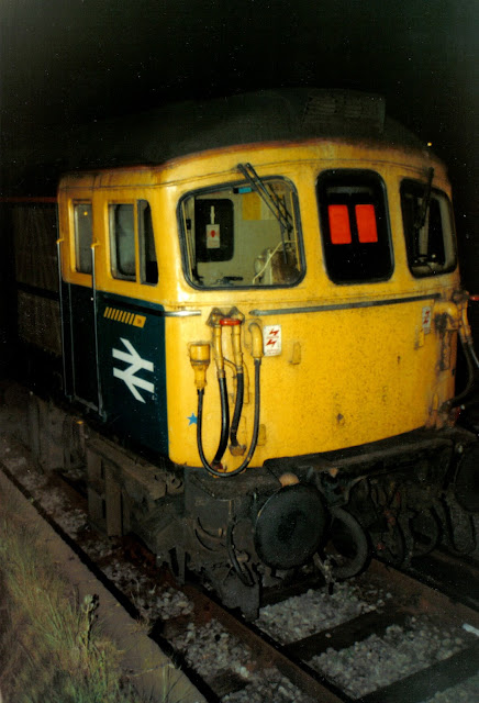 Night Photo of the cab front of a Crompton Class 33 locomotive on sidings at Basingstoke station